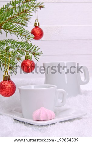 Meringue and white cup with a milkman - stock photo