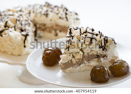 meringue cake slice on plate with glazed chestnuts