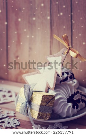 Meringue cookies and christmas gifts / Sweet holidays desert with christmas decorations/ Christmas background - stock photo