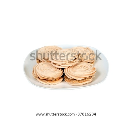 Meringue cookies on a white plate isolated on white - stock photo