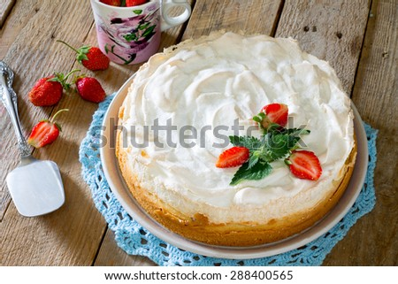 Meringue tart with strawberries - stock photo
