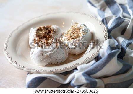 Meringues on a plate - stock photo