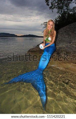 Mermaid an shell - stock photo