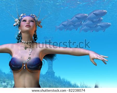 Mermaid Dreams - This beautiful mermaid has grace and elegance in her underwater world. - stock photo