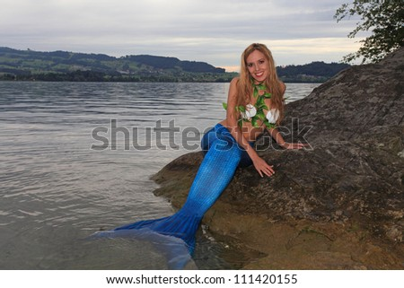 Mermaid on the coast - stock photo