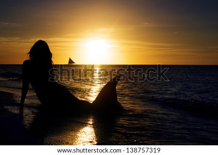 mermaid on tropical sea background - stock photo