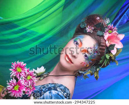 Mermaid. Portrait of young woman in creative image and with flowers. - stock photo