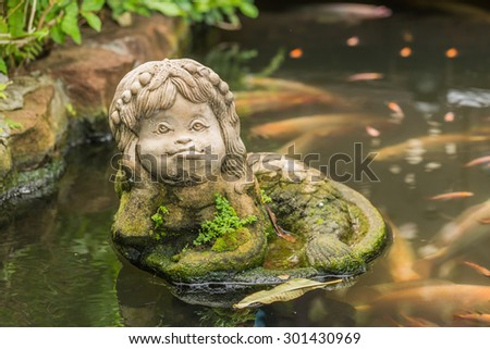 Mermaid statue in the pond