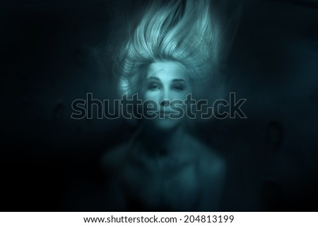 Mermaid.Toned photo of face under water - stock photo