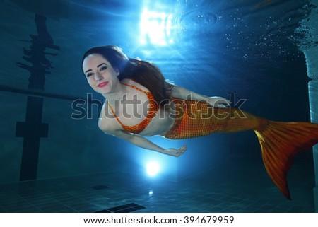 Mermaid underwater in the pool  - stock photo