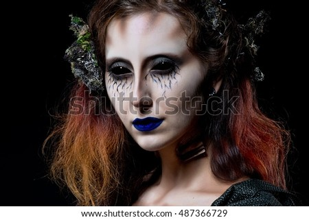 Mermaid. Woman monster. Creative dark make-up, conceptual idea for Halloween. Eerie nightmare turning into a black mermaid