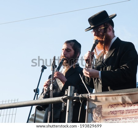 MERON, ISRAEL - MAY 18, 2014: Orthodox Jews play music and sing to the dancing crowd at the annual hillulah of Rabbi Shimon Bar Yochai, in Meron, on Lag BaOmer Holiday - stock photo