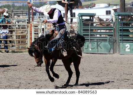 MERRITT, B.C. CANADA - SEPTEMBER 3: Cowboy during saddle bronc event at The 52nd Annual Pro Rodeo September 3, 2011 in Merritt British Columbia, Canada - stock photo