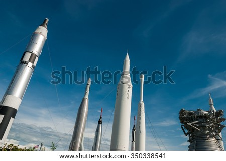 MERRITT ISLAND, FLORIDA - JUNE 7, 2013: The Rocket Garden at Kennedy Space Center NASA.  Tourist attraction, rockets from explorations for every United States of America human space flight since 1968 - stock photo