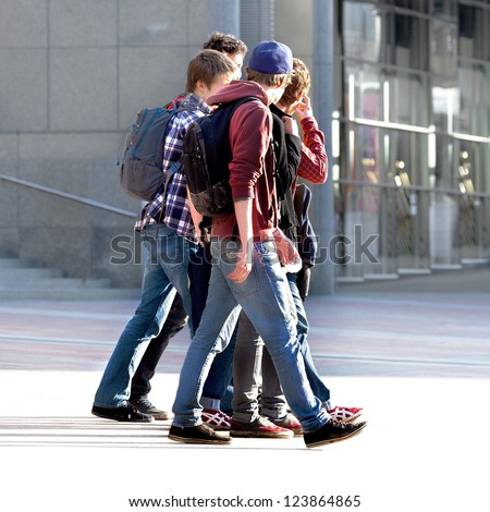 Merry band of teenagers. Urban scene. - stock photo