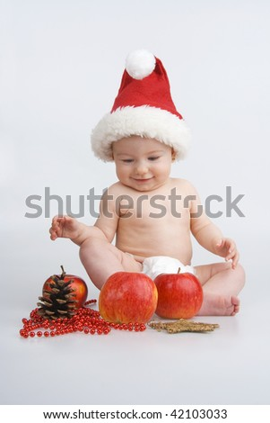 Merry child and Christmas decoration,on white background. - stock photo