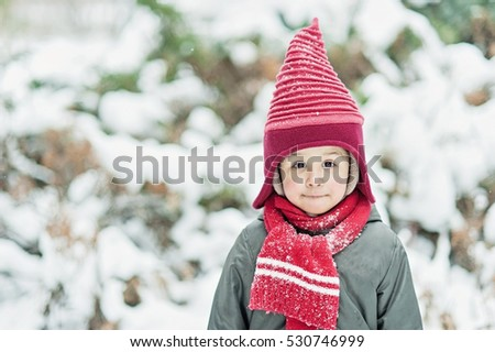 Merry Christmas and Happy Holiday! Cute little child boy in funny elf hat outdoor