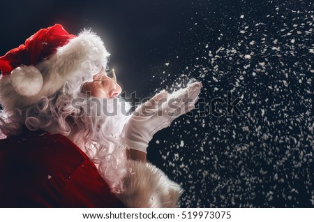 Merry Christmas and happy holidays! Santa Claus blows snow.