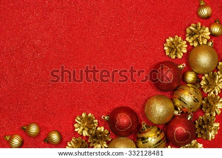 Merry Christmas and Happy New Year festive background with red and gold balls and pine cones - stock photo