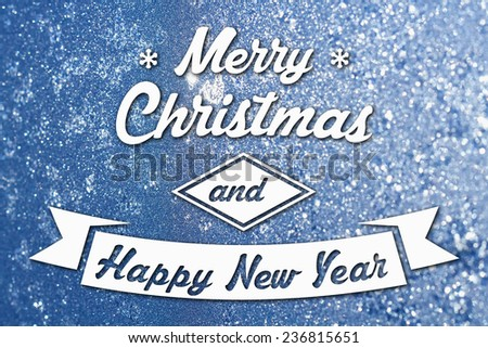Merry Christmas and New Year greeting card on frozen winter blue colored background