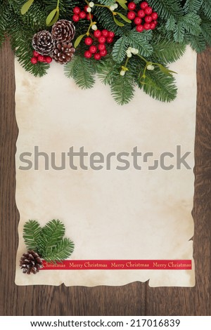 Merry christmas background border with fir, red berry sprays, mistletoe and pine cones over old parchment paper and oak wood.   - stock photo