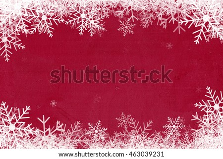 merry christmas background. snowflakes with red wood  texture