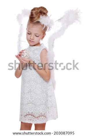 merry christmas background with little angel praying to god/Portrait of modern little angel on Christmas on Holiday theme - stock photo