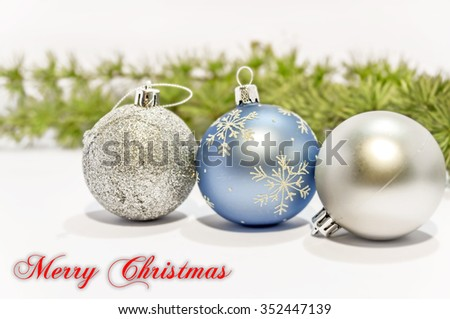 Merry Christmas, blue and gray decorative ball on the white background