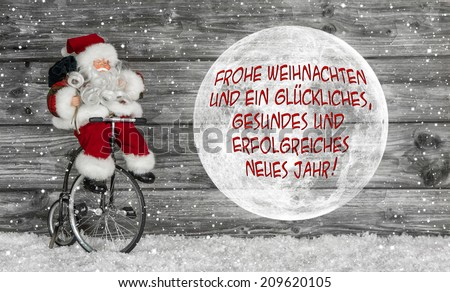 "Merry christmas card in red and white with german text ""Merry christmas and a happy health and successful new year"" and a santa claus.  - stock photo"