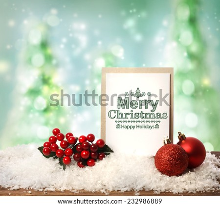 Merry Christmas card with baubles mistletoe and snow flakes - stock photo