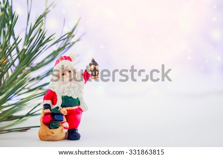 Merry christmas card with Santa Claus figurine. Lights background with space for text. Winter holidays. Xmas theme - stock photo