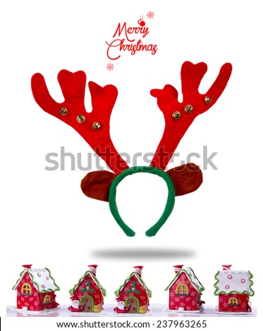 Merry Christmas. Christmas funny red reindeer mask with horns. Red Christmas background with deer hair band and red houses . - stock photo