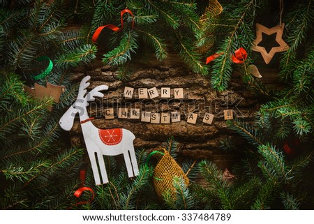 Merry Christmas. Christmas greeting card with rustic wood and ornaments. Xmas background. - stock photo