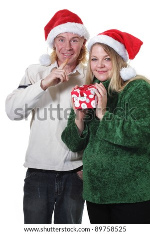 Merry Christmas couple sharing gifts - stock photo