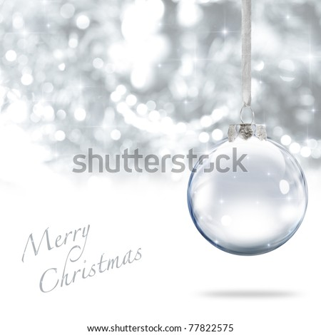 Merry Christmas glass ball against silver background - stock photo