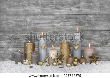 Merry christmas greeting card: wooden grey shabby chic background with candles. - stock photo