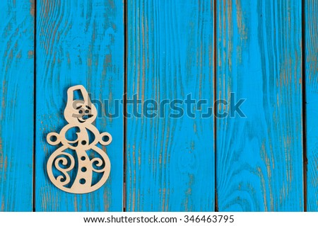Merry Christmas greeting wooden background with snowman. Empty space for text. - stock photo