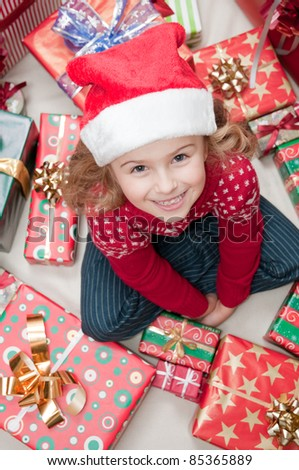 Merry Christmas - happy little girl with Christmas presents - stock photo