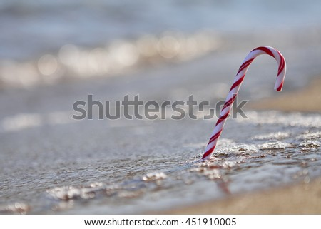 Merry Christmas Happy New Year background, candy on the beach