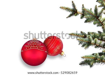 Merry Christmas. Happy New Year.Red baubles and Christmas tree branches against white background.Fireworks,fairy stars and sparkles celebration composition. Holidays. Winter festive background