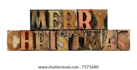 Merry Christmas in old, ink-stained letterpress wood type, all caps, isolated on white - stock photo
