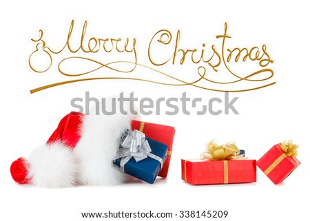 Merry Christmas inscription and red santa hat with gift boxes isolated on white background - stock photo