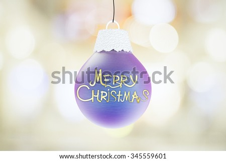 Merry Christmas lettering on blue christmas tree ball - stock photo