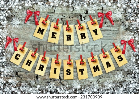 Merry Christmas lettering with clothes-peg in shape of train on abstract background - stock photo