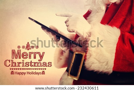 Merry Christmas message with Santa Claus with tablet - stock photo