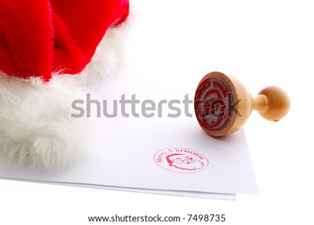 Merry christmas rubber stamp near red hat - stock photo