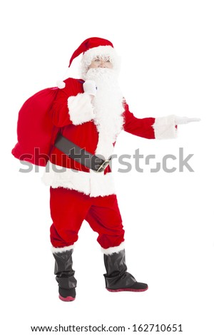 merry Christmas Santa Claus holding gift bag and showing - stock photo