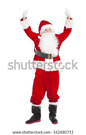 merry Christmas Santa Claus with thumb up - stock photo