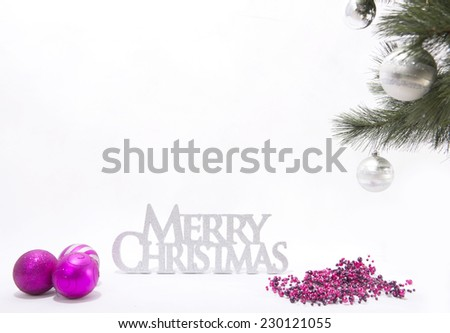 Merry Christmas sign with pink baubles and tree.