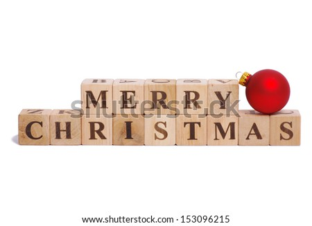 merry christmas spelled out in wooden blocks